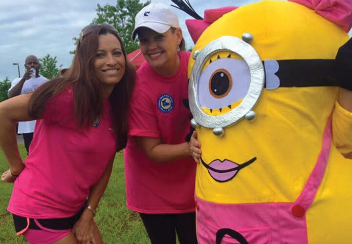 Tallahassee dental team members posing with minion
