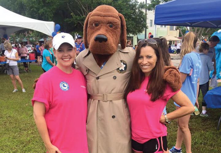 Tallahassee dental team members posing with mascot