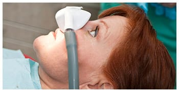 Woman with nitrous oxide sedation mask