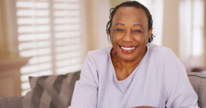 Woman smiles with dental implants and jaw preservation
