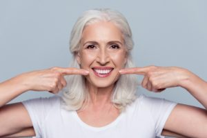 Older woman with dental implants in Tallahassee.