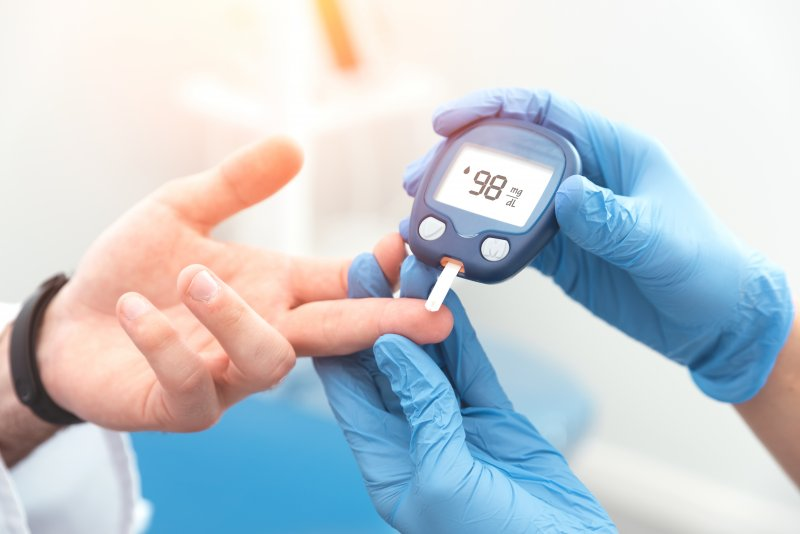 doctor checking blood sugar levels